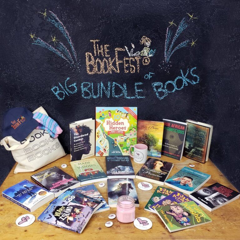 """Several books and other prizes displayed on a table with a sign that reads """"The BookFest Big Bundle of Books"""""""